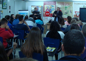 Learners in road safety class during Motorbikes Conferences 2013 of Granada listening Vespacito association